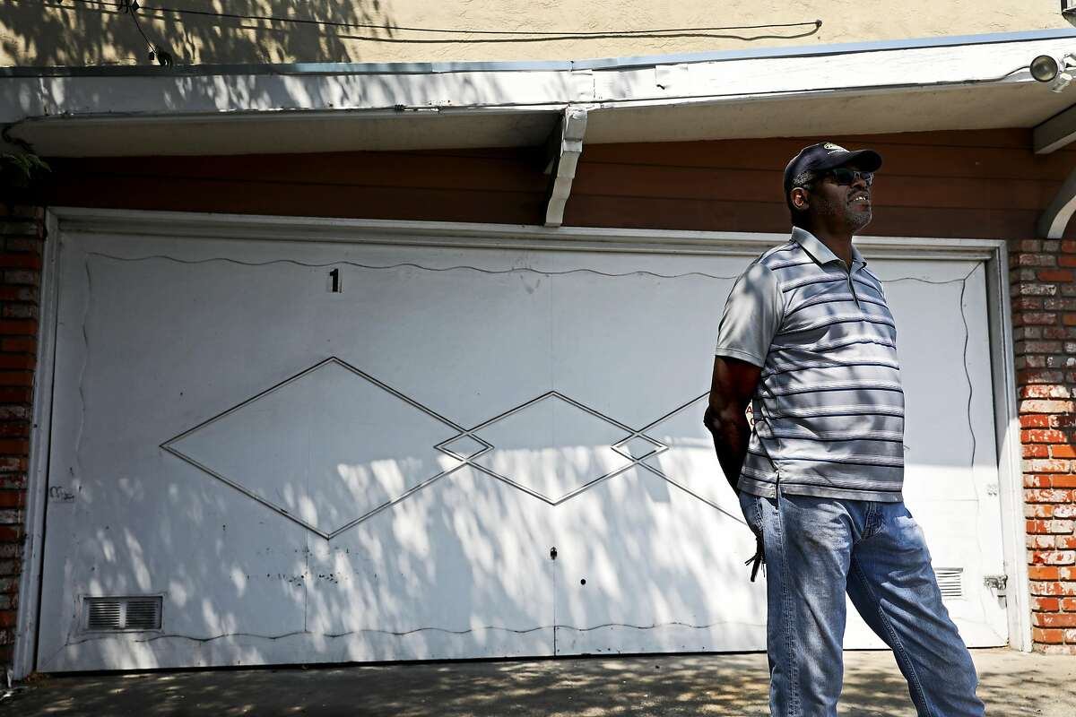 """Johnny Burks poses for a portrait at 3205 Beaumont Ave. in Oakland, Calif., on Saturday, August 18, 2018. Burks, 67, rents the four-unit building for Section 8 housing. In January, Oakland launched a first-of-its-kind program that gives financial incentives to landlords renting Section 8 apartments to low-income families. The city says the program is off to a strong start. Burks, who has been renting out Section 8 apartments for four decades, says the new program is promising. Burks also thinks more property owners should participate because that's the only way affordable housing stock will immediately increase in the city. The Oakland Housing Authority needs more units. There are 145 families on a waiting list for Section 8 housing. """"The face of Oakland is changing for both landlords and tenants with all the growth and all the building and all the new development that's taking over Oakland. It's out of control,"""" Burks said. """"It's going to change the face because the new buildings, the new apartments that are being built are not for low and moderate income families. In essence, that's pushing people of color and people that utilize the Oakland Housing Authority, it's pushing them to a different part of Oakland and it's impacting the number of rental units that are available. It's also penalizing the tenants because now greedy landlords are gonna want to get them out so that they can get top dollar for their units. I can just see when there's change and everything is escalating the price, the cost of renting is escalating and people are moving out, then that's gonna change the neighborhood, it's gonna change the schools, it's gonna change the shopping, it's just gonna change the culture of Oakland and, in essence, push us out."""