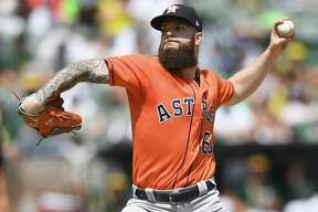 OAKLAND, CA - AUGUST 18: Dallas Keuchel #60 of the Houston Astros pitches against the Oakland Athletics in the bottom of the first inning at Oakland Alameda Coliseum on August 18, 2018 in Oakland, California. (Photo by Thearon W. Henderson/Getty Images)