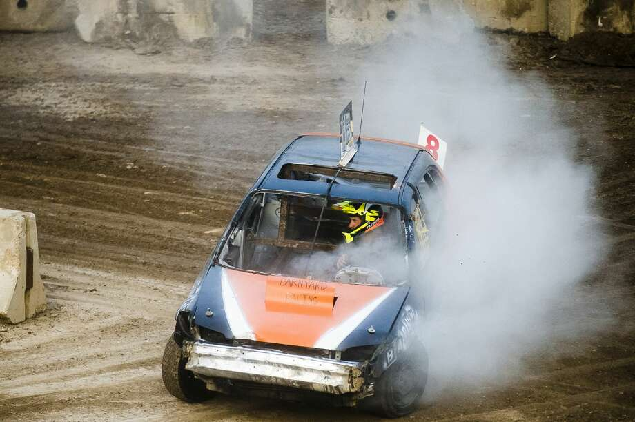 Drivers race around the track during the Auto Cross and Demolition Derby on Saturday, Aug. 18, 2018 at the Midland County Fairgrounds. (Katy Kildee/kkildee@mdn.net) Photo: (Katy Kildee/kkildee@mdn.net)