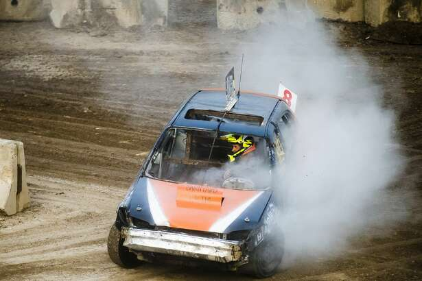 Drivers race around the track during the Auto Cross and Demolition Derby on Saturday, Aug. 18, 2018 at the Midland County Fairgrounds. (Katy Kildee/kkildee@mdn.net)