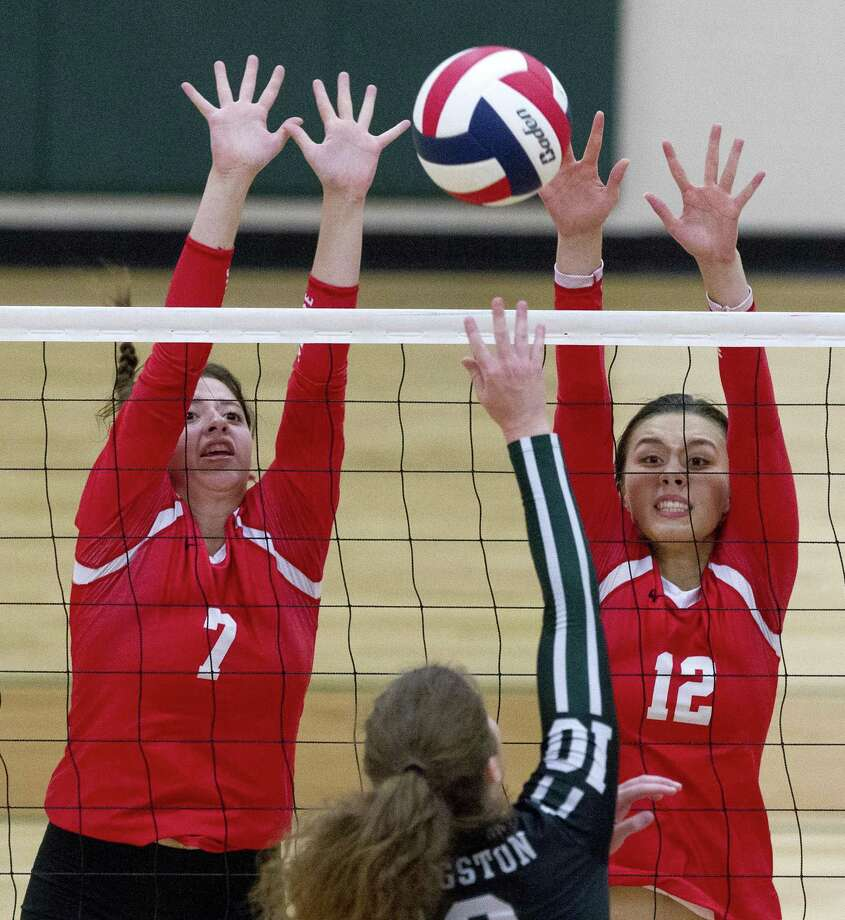 Porter's Hannah Fritsch (12) and Lauren Wootton (7) pressure a hit in the first set of a match during the Huntsville volleyball tournament at Huntsville High School on Saturday, Aug. 11, 2018, in Huntsville. Photo: Jason Fochtman, Staff Photographer / Staff Photographer / © 2018 Houston Chronicle