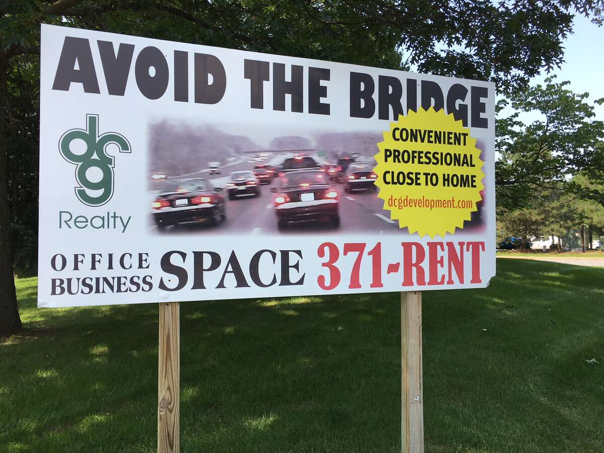 Signs for office space in Clifton Park emphasize the commuting headaches the Twin Bridges can pose on the Northway.