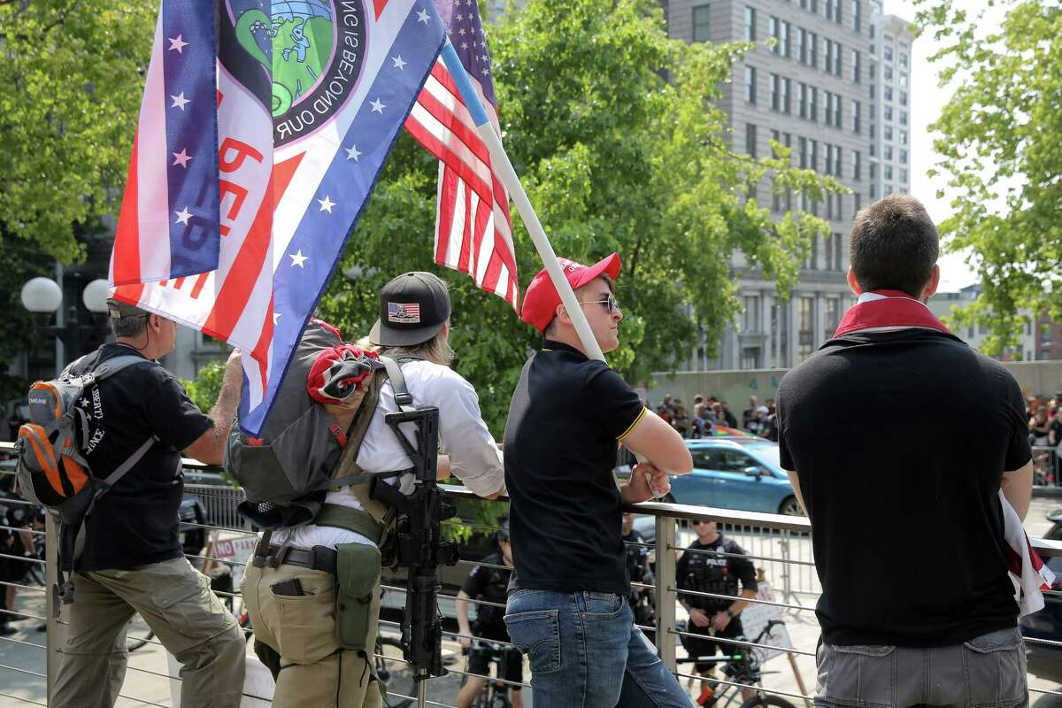 About 200 people from right-wing groups Washington 3 Percenters and Patriot Prayer held a