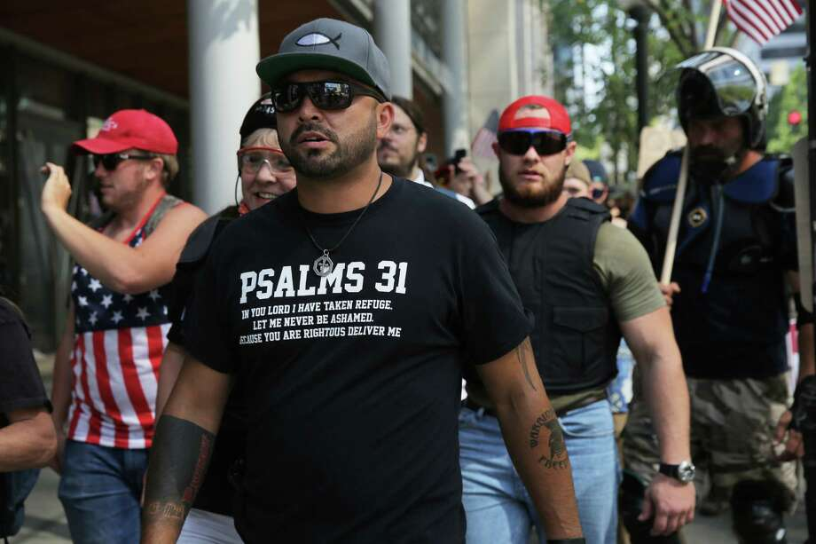 "Patriot Prayer leader Joey Gibson leads a march as around 200 people from right-wing groups Washington 3 Percenters and Patriot Prayer held a ""Liberty or Death"" rally at Seattle City Hall, in part, to oppose Washington gun-control Initiative 1639, Saturday, Aug. 18, 2018. Counter-protesters lined the other side of the street, at least two men were arrested. Photo: GENNA MARTIN, SEATTLEPI.COM / SEATTLEPI.COM"