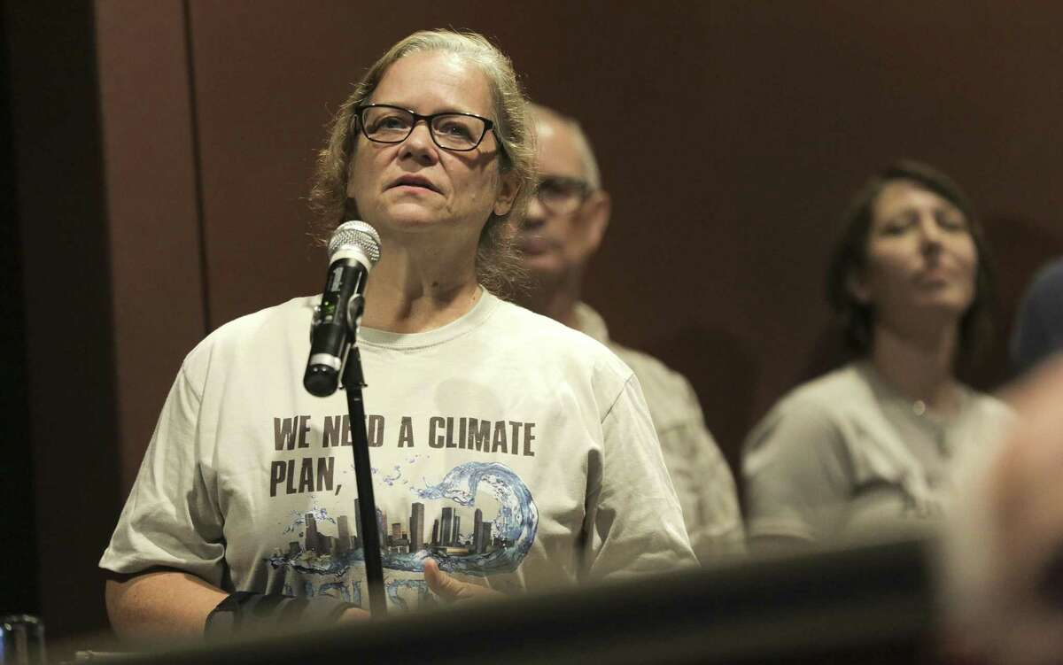 Sheila Blake of Houston asks questions of during a town hall on climate change hosted by Houston Climate Movement on Saturday, Aug. 18, 2018 in Houston.