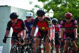 Cyclists compete on Saturday afternoon in the Category 5 race at TheBANK of Edwardsville Rotary Criterium in downtown Edwardsville.