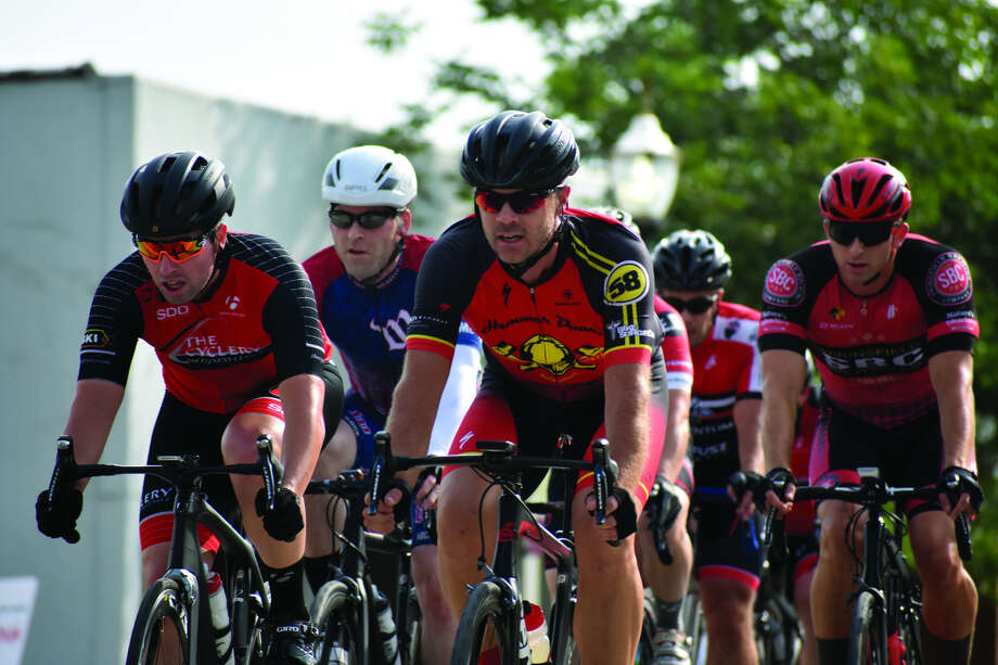 Cyclists compete on Saturday afternoon in the Category 5 race at TheBANK of Edwardsville Rotary Criterium in downtown Edwardsville. Photo: Matthew Kamp