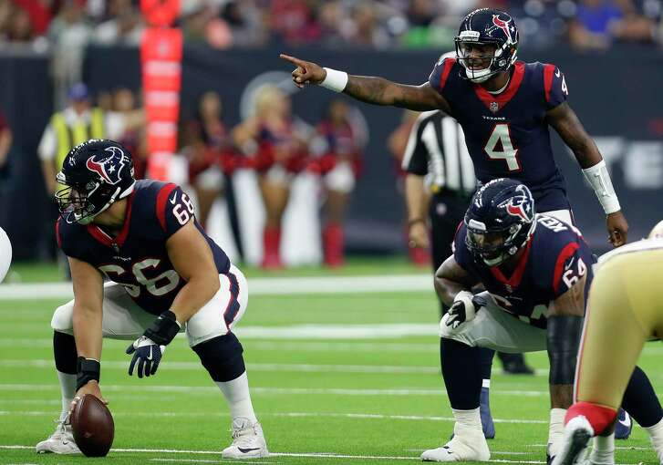 Houston Texans quarterback Deshaun Watson (4) runs a play at the line against the San Francisco 49ers during the first quarter of an NFL preseason football game at NRG Stadium on Saturday, Aug. 18, 2018, in Houston.