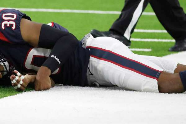 Houston Texans cornerback Kevin Johnson (30) was injured on a play against San Francisco 49ers wide receiver Marquise Goodwin during the first quarter of an NLF preseason game at NRG Stadium, Saturday, August 18, 2018, in Houston.