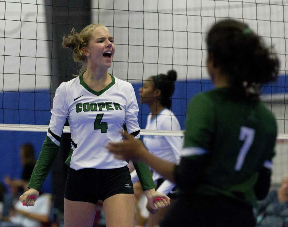 John Cooper's Olivia Overbeek (4) reacts after scoring a point in the first set of a match during the CHSM Invitational at Competitive Edge on Saturday, Aug. 18, 2018, in Spring. Photo: Jason Fochtman, Houston Chronicle / Staff Photographer / © 2018 Houston Chronicle