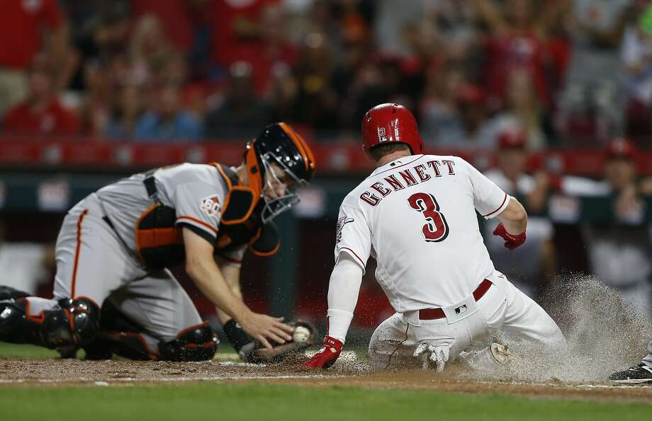 Cincinnati Reds' Scooter Gennett (3) scores on a sacrifice fly by Phillip Ervin as San Francisco Giants catcher Buster Posey, left, takes the throw during the fifth inning of a baseball game Saturday, Aug. 18, 2018, in Cincinnati. (AP Photo/Gary Landers) Photo: Gary Landers / Associated Press