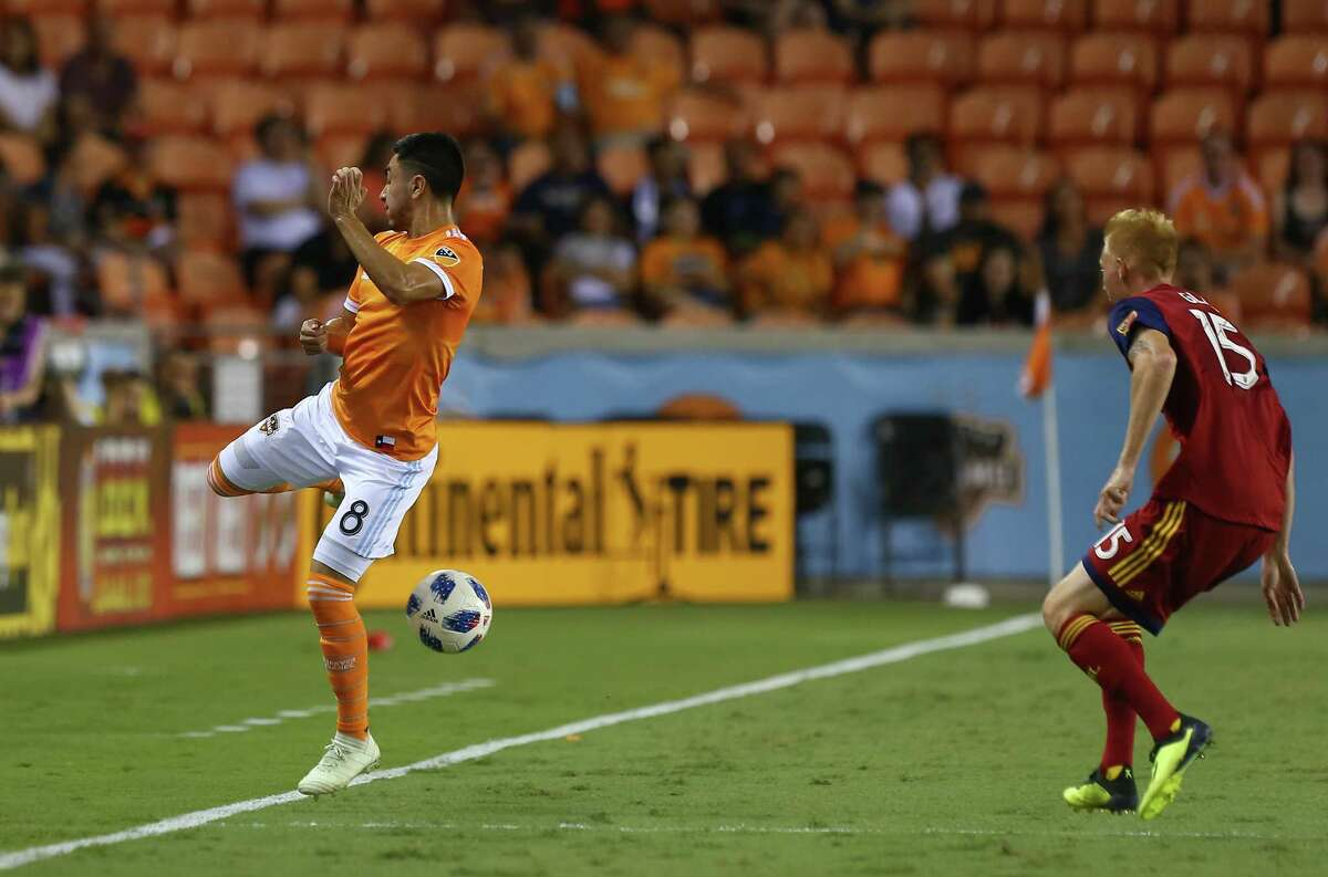 Houston Dynamo midfielder Memo Rodriguez (8) keeps the ball inbound during the first half of an MLS match against the Real Salt Lake at BBVA Compass Stadium Saturday, Aug. 18, 2018, in Houston.