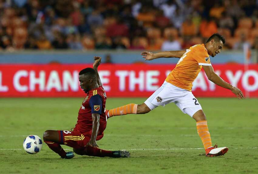Real Salt Lake midfielder Stephen Sunny Sunday (8) takes the ball away from Houston Dynamo midfielder Darwin Ceren (24) during the first half of an MLS match at BBVA Compass Stadium Saturday, Aug. 18, 2018, in Houston.