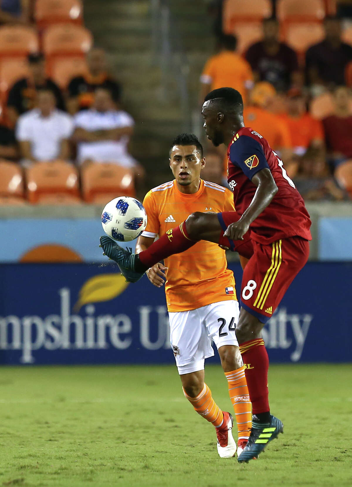 Real Salt Lake midfielder Stephen Sunny Sunday (8) gains possession of the ball during the first half of an MLS match against the Houston Dynamo at BBVA Compass Stadium Saturday, Aug. 18, 2018, in Houston.
