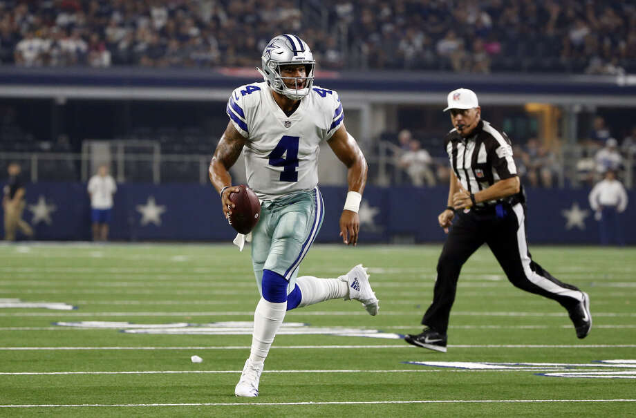 Dallas Cowboys quarterback Dak Prescott (4) scrambles during the first half of a preseason NFL football game against the Cincinnati Bengals in Arlington on Saturday. Photo: Ron Jenkins|Associated Press