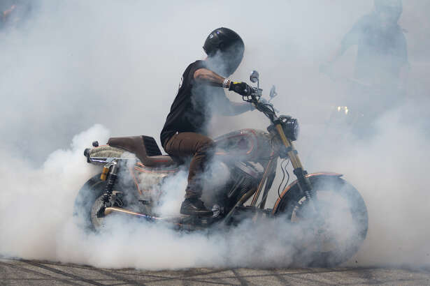 Roger Regan does a burn out at the Moto Bay Classic on Pier 32 in San Francisco on Saturday, August 18, 2018.