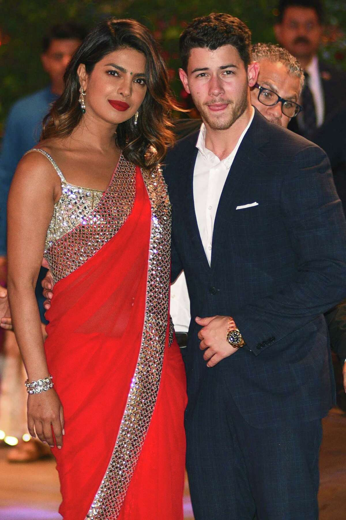 (FILES) In this file photo taken on June 28, 2018, Indian Bollywood actress Priyanka Chopra (L) accompanied by US singer Nick Jonas arrive for the pre-engagement party of India's richest man and Reliance Industries Limited Chairman, Mukesh Ambanis eldest son Akash Ambani and fiancee Shloka Mehta in Mumbai. Chopra is engaged to Jonas after a whirlwind two months of dating, People magazine, citing unnamed sources close to the pair, reported on July 27, 2018. / AFP PHOTO / SUJIT JAISWALSUJIT JAISWAL/AFP/Getty Images
