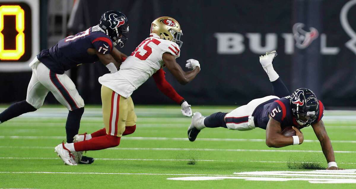 Houston Texans quarterback Joe Webb (5) stumbles as San Francisco 49ers defensive back Tarvarius Moore (45) comes in for the tackle during the third quarter of an NFL preseason football game at NRG Stadium on Saturday, Aug. 18, 2018, in Houston.