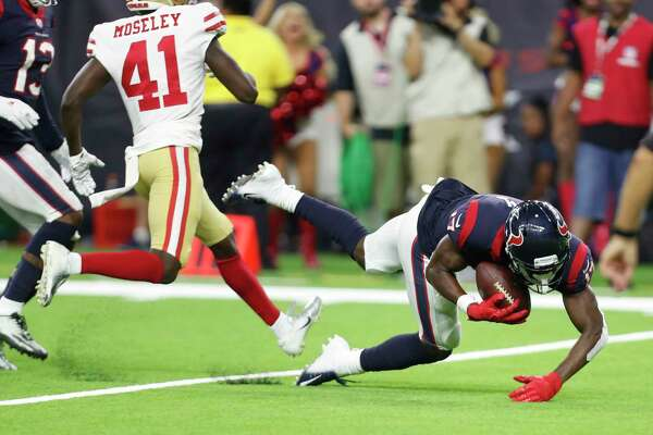 Houston Texans wide receiver Vyncint Smith (17) catches a touchdown pass from quarterback Joe Webb in the final moments during the fourth quarter of an NFL preseason football game at NRG Stadium on Saturday, Aug. 18, 2018, in Houston.