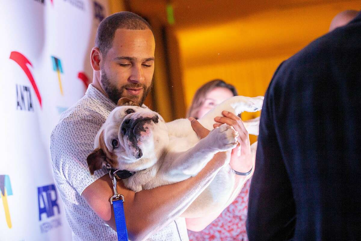 Mychel Thompson with dog Rocco at the red carpet for the Thompson Family Foundation at Hotel Vitale, Saturday, Aug. 18, 2018, in San Francisco, Calif.