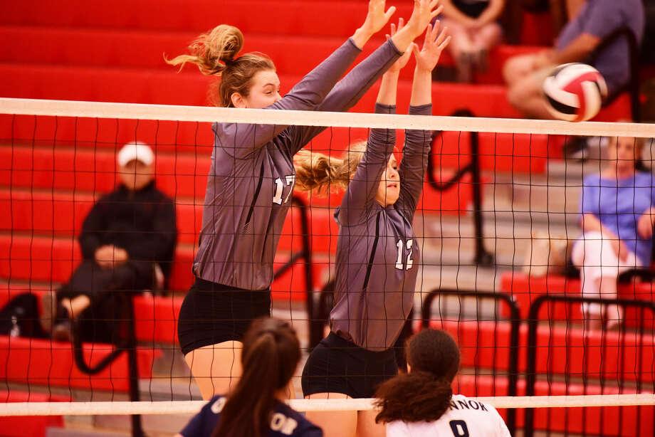 Clark's Kara McGhee (left) and Taylor McDonough go up for a block vs. O'Connor. Photo: Gerald Castillo