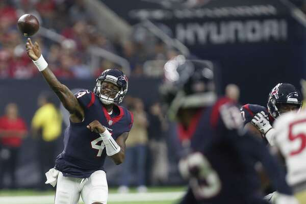 Texans quarterback Deshaun Watson throws a pass to wide receiver Braxton Miller during the first quarter. Watson completed 5 of 8 passes for 73 yards, one touchdown and no interceptions.