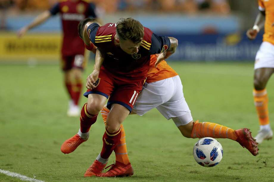 Real Salt Lake midfielder Albert Rusnak (11) gets around Houston Dynamo midfielder Tomas Martinez (10) during the second half of an MLS match at BBVA Compass Stadium Saturday, Aug. 18, 2018, in Houston. Real Salt Lake won 2-1. Photo: Godofredo A. Vasquez, Houston Chronicle / Staff Photographer / 2018 Houston Chronicle