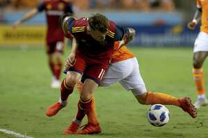 Real Salt Lake midfielder Albert Rusnak (11) gets around Houston Dynamo midfielder Tomas Martinez (10) during the second half of an MLS match at BBVA Compass Stadium Saturday, Aug. 18, 2018, in Houston. Real Salt Lake won 2-1.
