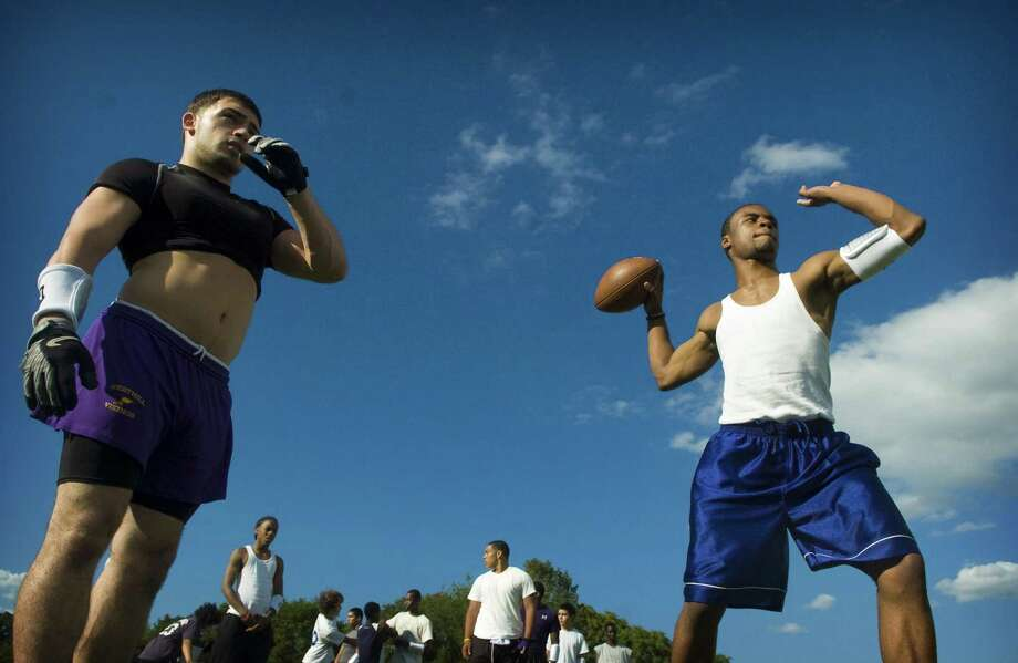 Team captains Danny Berisha, 18, left, and Adler Florian, 17, run a drill during the second day of football practice at Westhill High School on Tuesday, August 19, 2008. Photo: Chris Preovolos / File Photo