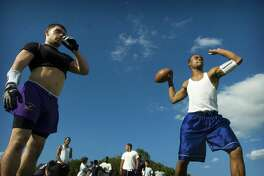 Team captains Danny Berisha, 18, left, and Adler Florian, 17, run a drill during the second day of football practice at Westhill High School on Tuesday, August 19, 2008.