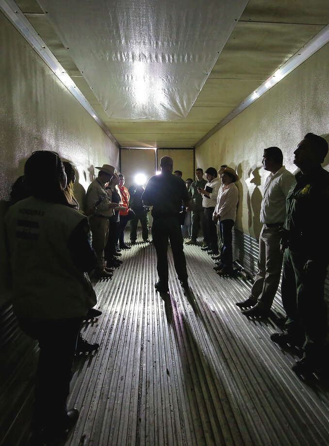 In this file photo, Laredo Sector Border Patrol Chief Mario Martinez, center, speaks to members of media, as they reenact a human smuggling scenario inside a tractor trailer, during the Border Safety Initiative Media Tour. Photo: Victor Strife/Laredo Morning Times