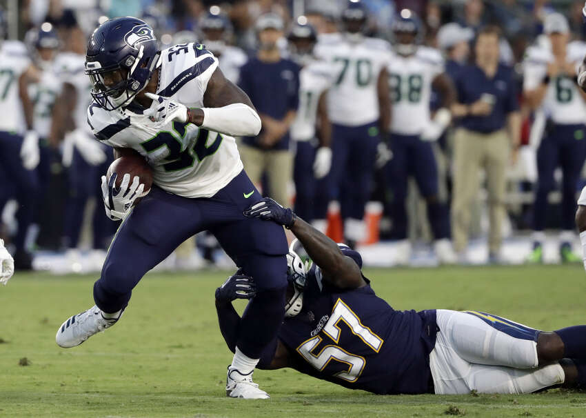 CHRIS CARSON IS THAT DUDE  With first-round pick Rashaad Penny out with a broken finger, Chris Carson continued to assert himself as RB No. 1 for the Seahawks.  It wasn't all good for the second-year tailback on Saturday -- he had a fumble at the goal line in the second quarter -- but he showed the power and fluidity on the ground that the Seahawks have expressed excitement about since the offseason. He had a particularly strong opening drive, which featured a 23-yard touchdown run (that was called back due to a Seahawks' penalty at the line of scrimmage).  Carson finished the game with nine rushes for 34 yards, including a long of 12 yards.