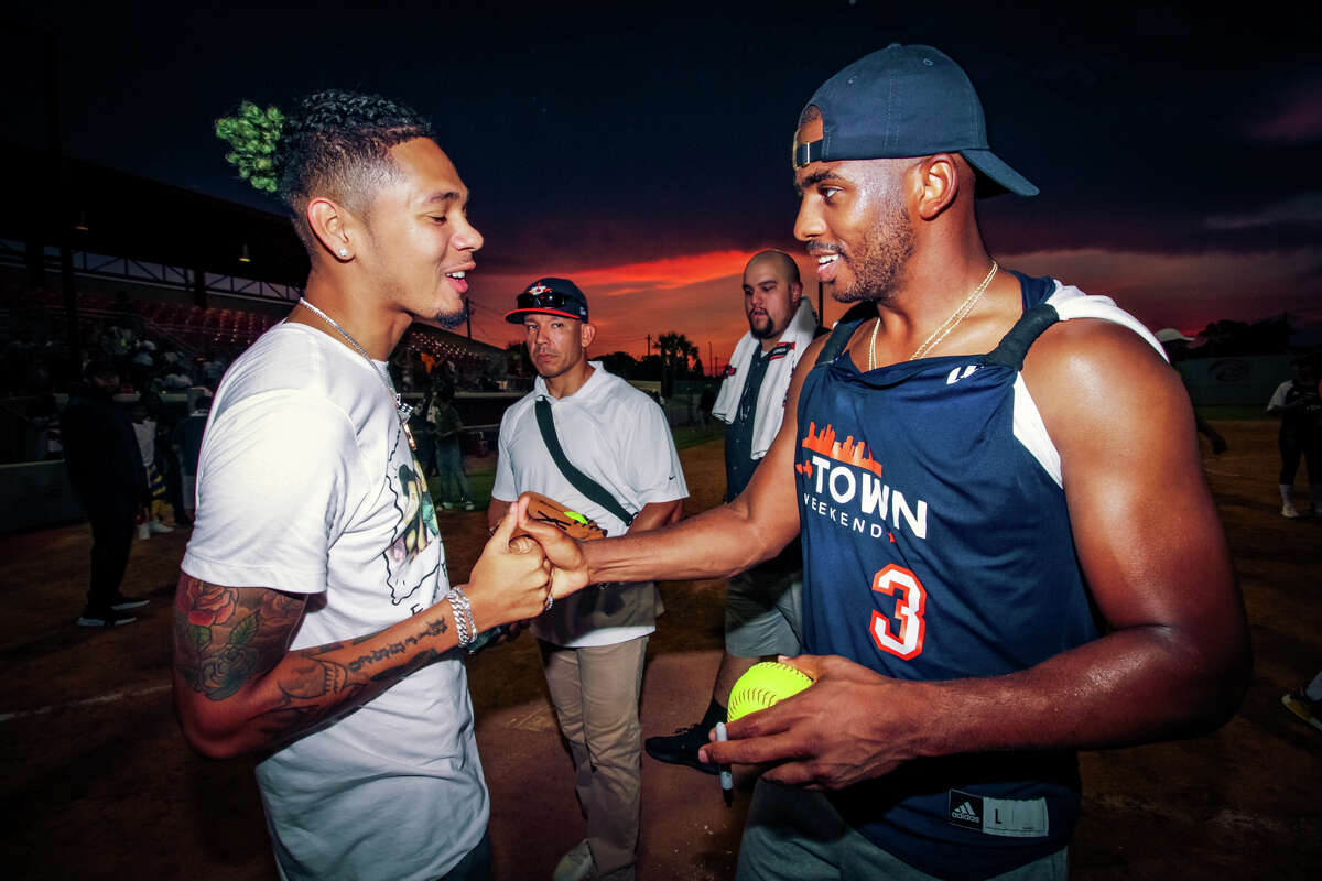 Rapper Dice Soho and Chris Paul conversate after the celebrity softball game at the University of Houston on day two of the 2018 JH-Town Weekend presented by Houston Rockets superstar James Harden. (Photo by Marco Torres/@MarcoFromHouston)