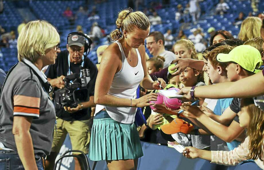 Czech Petra Kvitova signs autographs after defeating Canadian Eugenie Bouchard, 6-3, 6-2, in the second round in 2016, at the Connecticut Open at Yale University in New Haven. Photo: Catherine Avalone / Hearst Connecticut Media File Photo / New Haven RegisterThe Middletown Press