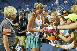 Czech Petra Kvitova signs autographs after defeating Canadian Eugenie Bouchard, 6-3, 6-2, in the second round in 2016, at the Connecticut Open at Yale University in New Haven.