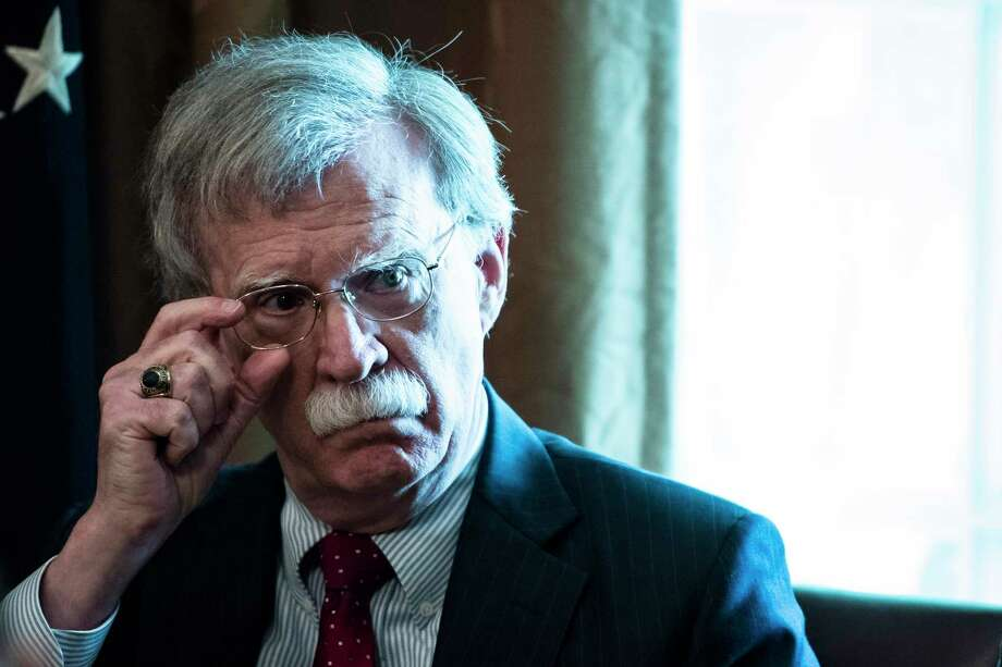 National security adviser John Bolton listens as President Donald Trump speaks during a Cabinet meeting at the White House on Aug 16. Photo: Washington Post Photo By Jabin Botsford / The Washington Post