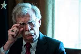 National security adviser John Bolton listens as President Donald Trump speaks during a Cabinet meeting at the White House on Aug 16.