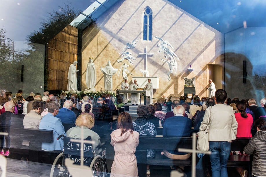 Visitors attend Mass in the chapel at Knock Shrine in County Mayo, Ireland, last week. Photo: Photo For The Washington Post By James Forde / James Forde