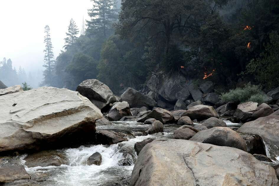 The Ferguson fire burns along a hillside near the Merced River in Yosemite, Calif., on Tuesday, Aug. 14, 2018. The Yosemite Valley reopened as firefighters strengthen containment of the Ferguson fire. (Gary Coronado/Los Angeles Times/TNS)