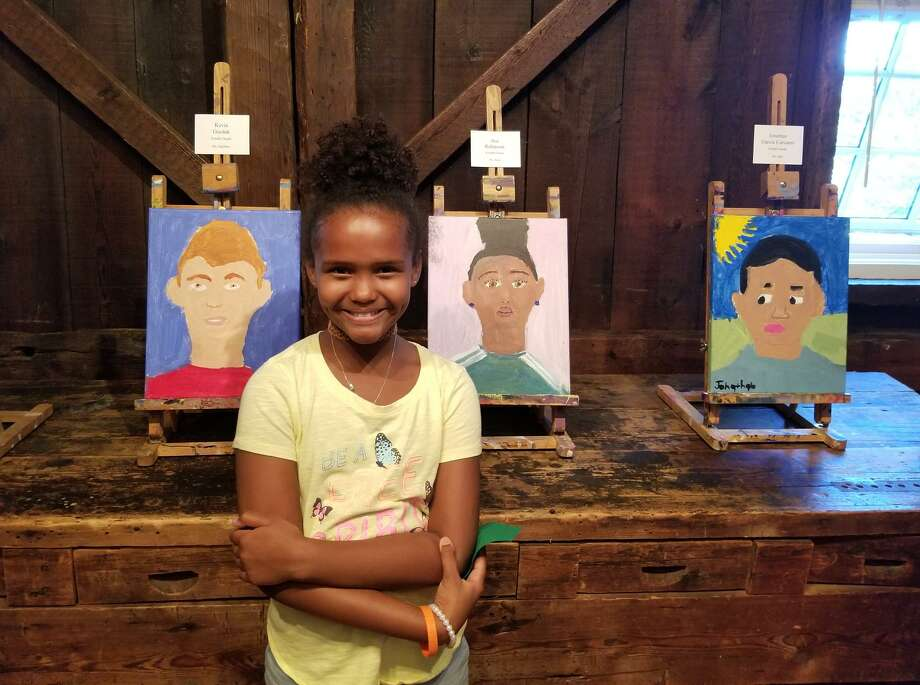 Hamilton Avenue School fourth-grader Ava Robinson with her self portrait. Hamilton Avenue students have been in partnership with the Greenwich Historical Society for 11 years.  The expanded Greenwich Historical Society campus and their work raising money for an endowment will provide opportunities for Julian Curtiss and New Lebanon schools as well. Photo: Contributed Photo / Greenwich Time Contributed