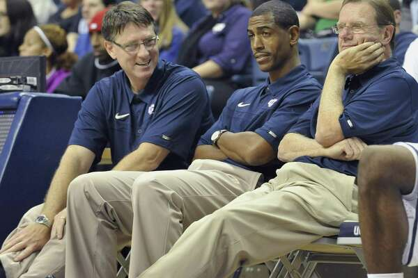Fomer UConn coach Kevin Ollie, middle, sits with former assistants Glen Miller, left, and George Blaney at First Night festivities in 2010. Ollie broke his media silence on Sunday for the first time since being ousted as UConn's coach in March.