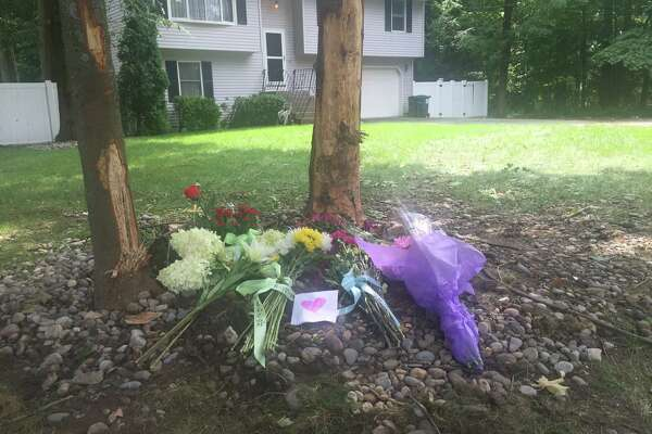 Mourners placed flowers at the site of the crash that killed Deacon Martucci, 16, late Friday night on Charlton Road in Glenville.
