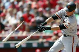 San Francisco Giants' Joe Panik hits a broken-bat single off Cincinnati Reds starting pitcher Luis Castillo during the third inning of a baseball game, Sunday, Aug. 19, 2018, in Cincinnati. (AP Photo/Gary Landers)