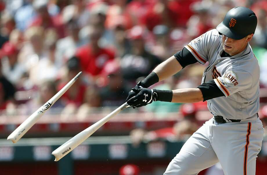 The Giants' Joe Panik hits a broken-bat single off the Reds'Luis Castillo in the third. It was one of the few highlights in another loss to last-place Cincinnati. Photo: Gary Landers / Associated Press