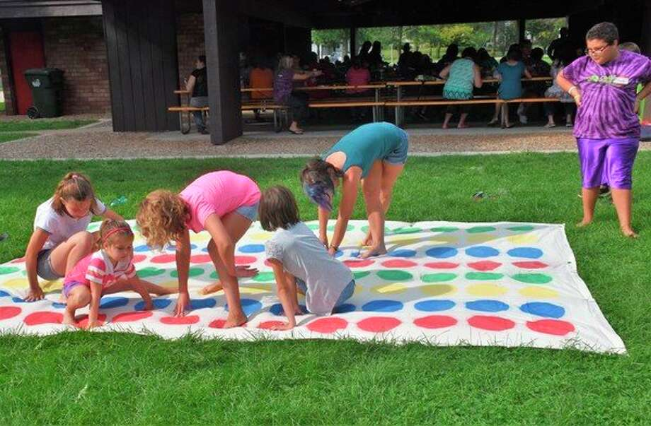 Kids have fun during a previous Children's Grief Center picnic. (Photo provided)