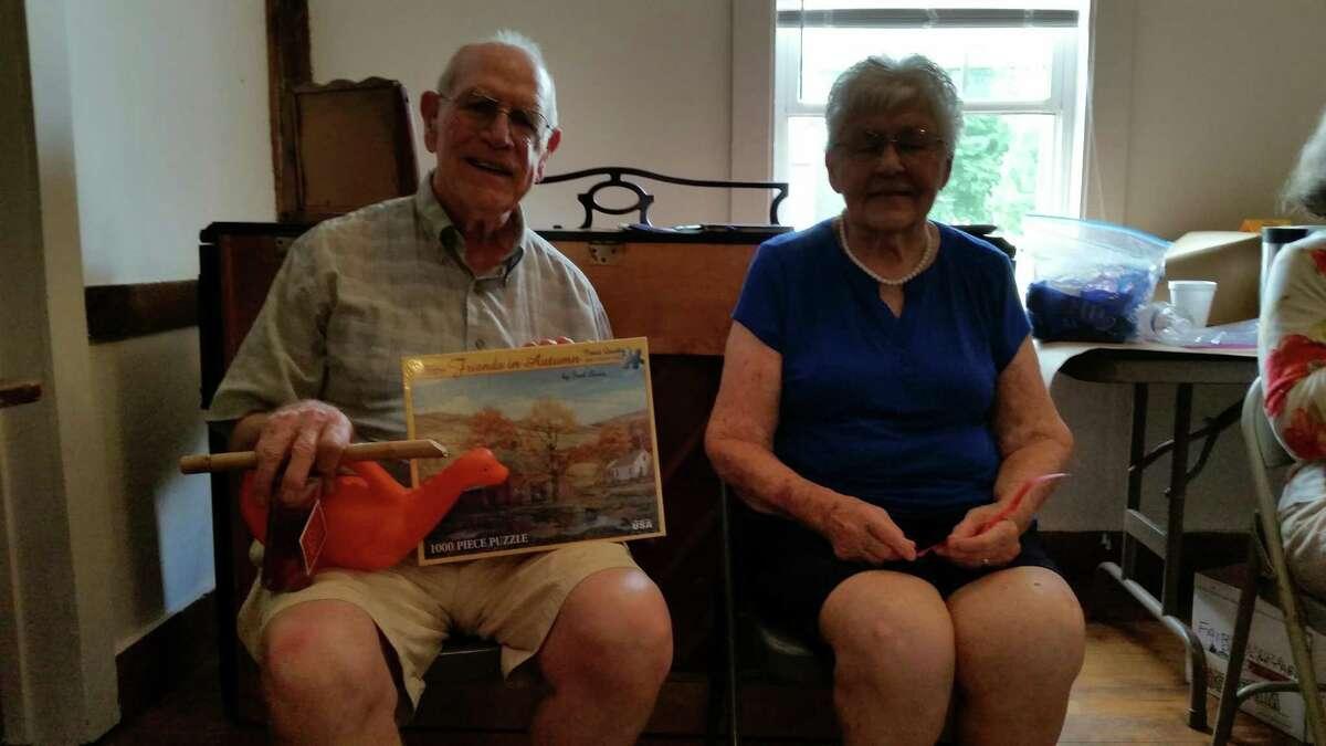 Raffle-prize winners and longtime Grange members Bob O?'Connor and Shirley Moore display their winnings.