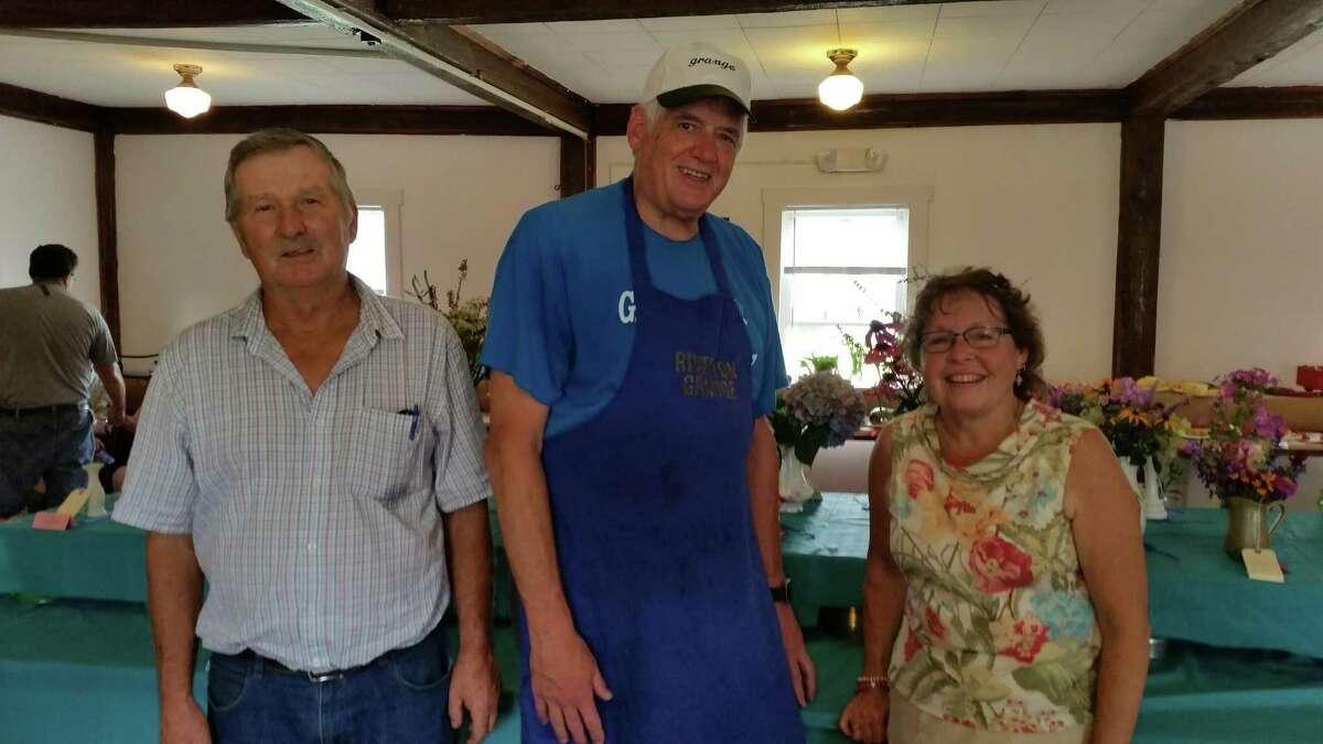Riverton Grange Fair members Dennis Jasmine, Raine Pedersen and Phil Prelli at the indoor fair.