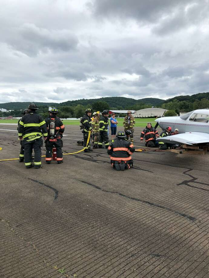 A plane touched down safely at Danbury Airport on Sunday, despite a problem with its landing gear. Photo: / Contributed Photo /Danbury Fire Department
