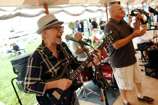 Lead guitarist Sal Salta performs with Tony Masi & the SummerTime Band at the second annual Taste of East Norwalk festival at the Longshore Pavilion at Norwalk Cove in Norwalk, Conn. Sunday, Aug. 19, 2018. Dozens of local restaurants and vendors were on hand, as well as a volleyball tournament, dance performance by Step'N'Out Dance Studios, and music from Tony Masi & the SummerTime Band.