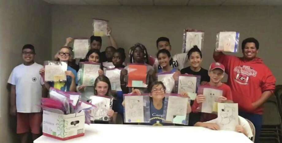 7th and 8th grade students participate in the Conroe Parks and Recreation Department Totally Teens Summer Program made Craft Packets for Texas Children's Hospital last month. This is an ongoing project of The Rotary Club of Conroe, with lots of help from the younger generation!
